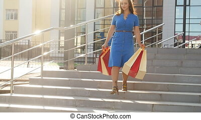 Young woman with packages after shopping - Young girl with...