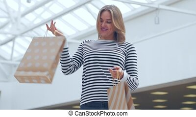 Young woman with packages in the city mall.