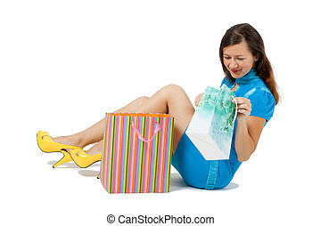 woman with packages sitting on the floor