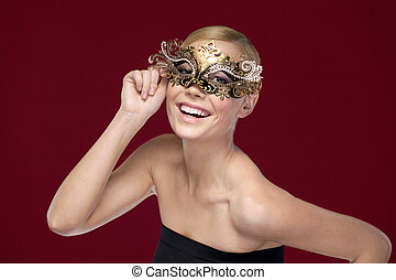Young woman with patterned masquerade mask