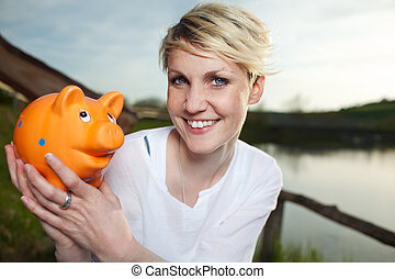 Young Woman With Piggy Bank Outdoors