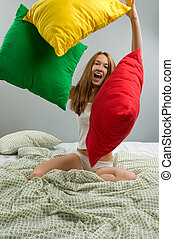 Young woman with pillows