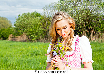 young woman with pink dirndl outdoor