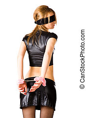 Young woman with pink handcuffs. Isolated on white.