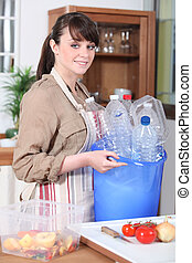 Young woman with plastic bottles