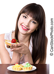 Young woman with plate of cakes