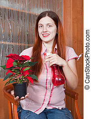 Young woman with Poinsettia flowers