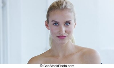Young woman with ponytail and naked shoulders - Beautiful...