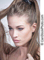 young woman with ponytail beauty portrait