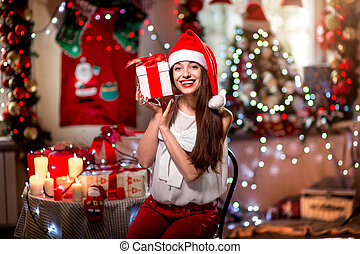 Young woman with present box on Christmas