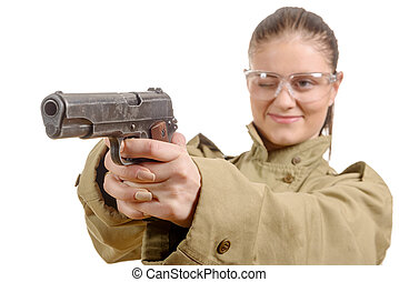 young woman with protective goggles holding a gun