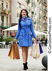 Young woman with purchases