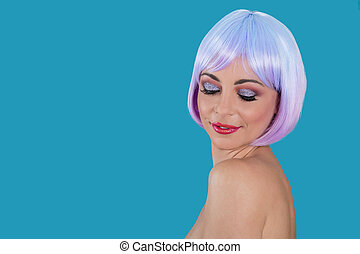 Young woman with purple hair on blue