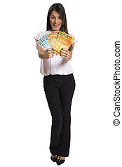 Young woman with real money in her hands, isolated on white background