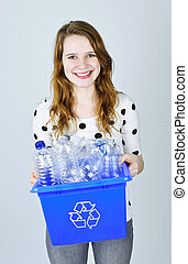 Young woman with recycling box