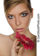 young woman with red chrysanthemum