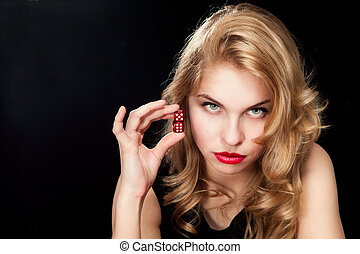 Young woman with red dice