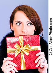 Young woman with red gift box