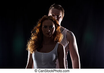 Young woman with red hair and man