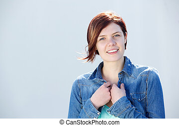 Young woman with red hair smiling