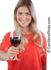 Young woman with red wine glass