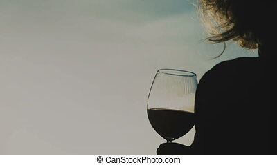 Young woman with red wine in glass