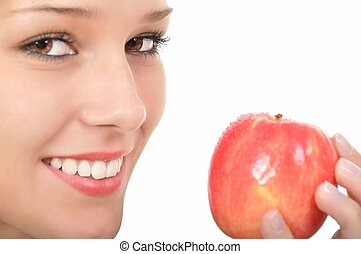 Young woman with red yellow apple