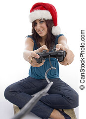 young woman with remote and christmas hat