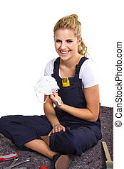 young woman with respirator laughs