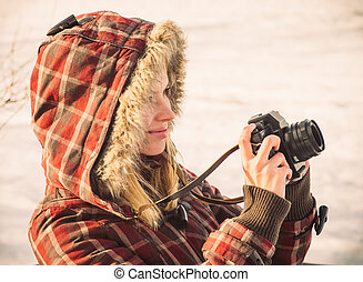 Young Woman with retro photo camera outdoor hipster Lifestyle with winter nature on background