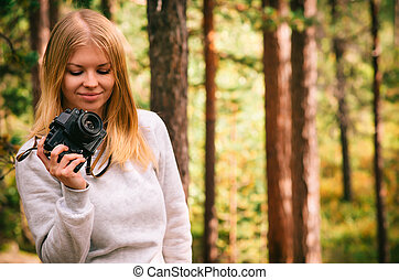 Young Woman with retro photo camera outdoor hipster...