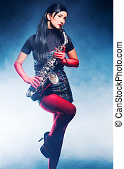 Young woman with saxophone