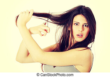 Young woman with scissors