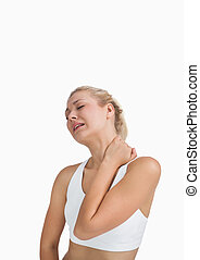 Young woman with severe neck pain over white background