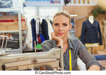 Young woman with sewing machine