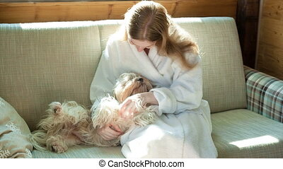 Young woman with shih-tzu dog