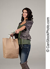 young woman with shopping and cash