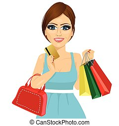 Young woman with shopping bags, handbag and credit card on a white background