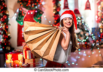 Young woman with shopping bags on Christmas - Young woman...