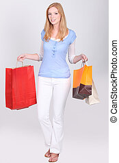 young woman with shopping bags