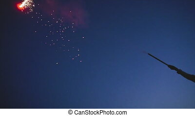 Young woman with short hair launching fireworks at summer ...