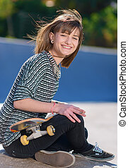 Young Woman With Skateboard And Cigarette