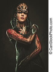 Young woman with spider body art and mask