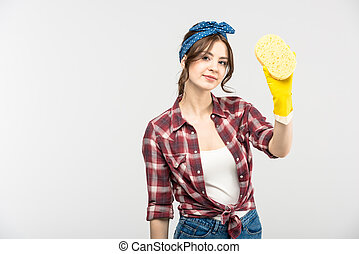 Young woman with sponge - Attractive young housewife holding...