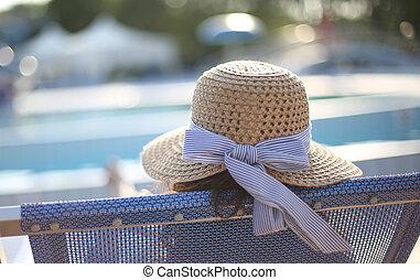 woman with straw hat sunbathing