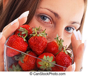 Young woman with strawberries