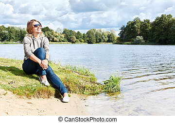 Young woman with sunglasses sitting