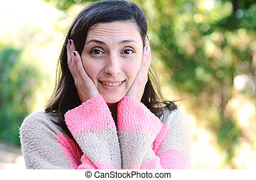 Young woman with surprised expression. Outdoor.
