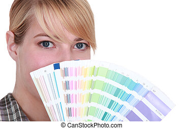 Young woman with swatches