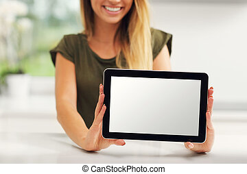 Young woman with tablet in kitchen